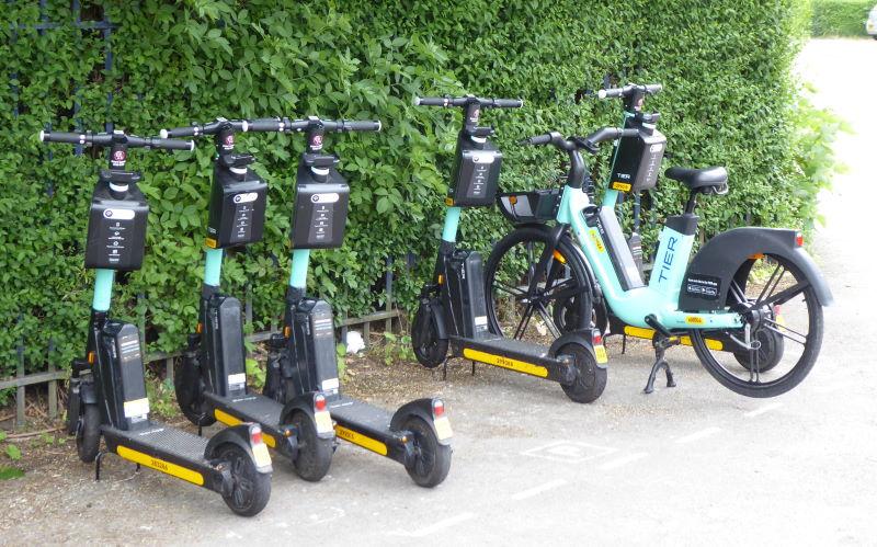 A row of e-scooters and an e-bike